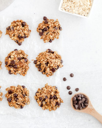 Six Gluten Free Rolled Oats Chocolate Chip Oat Cookies laying on wax paper