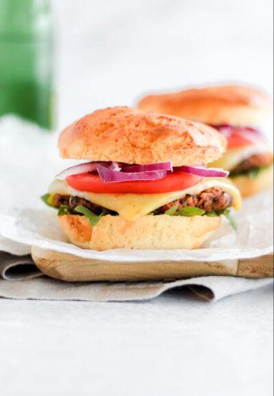 Easy Vegan Black Bean Burgers sitting on a wooden tray