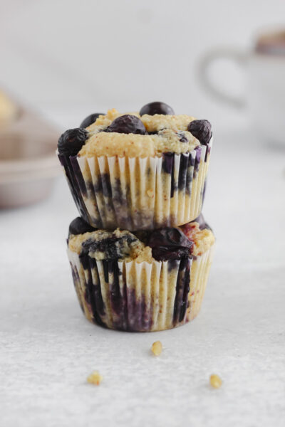 Two Gluten and Dairy Free Blueberry Lemon Muffins stacked on top of each other