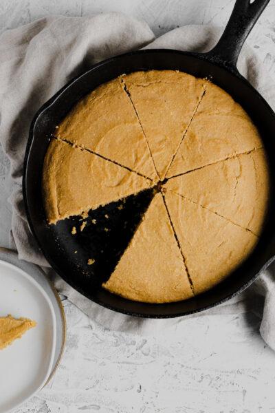 cast iron skillet filled with gluten free cornbread