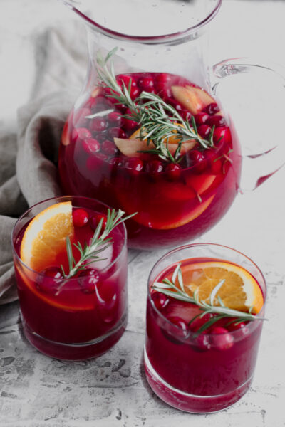 Pitcher and two glasses of Cranberry Orange Holiday Sangria