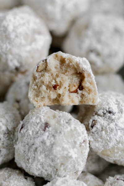 Gluten Free Snowball Cookies stacked on top of each other