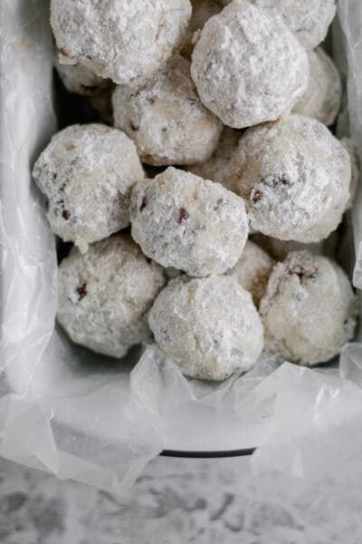 a tray filled with gluten free snowball cookies