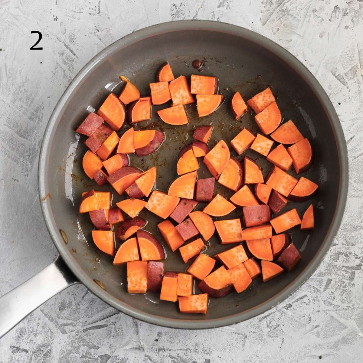 a pan with diced sweet potatoes inside