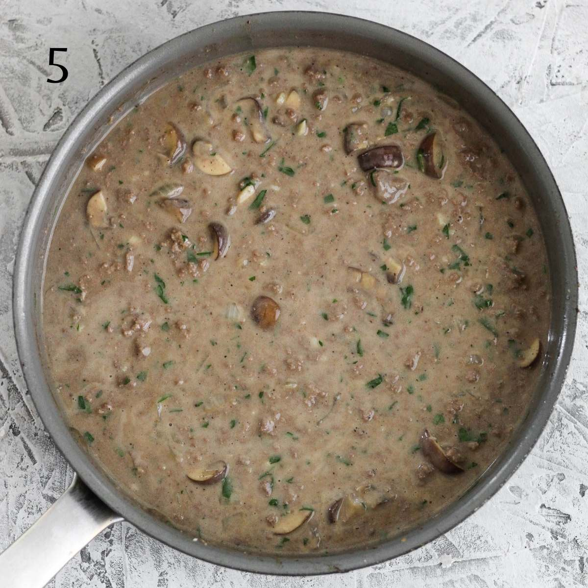 a pan with dairy free stroganoff sauce