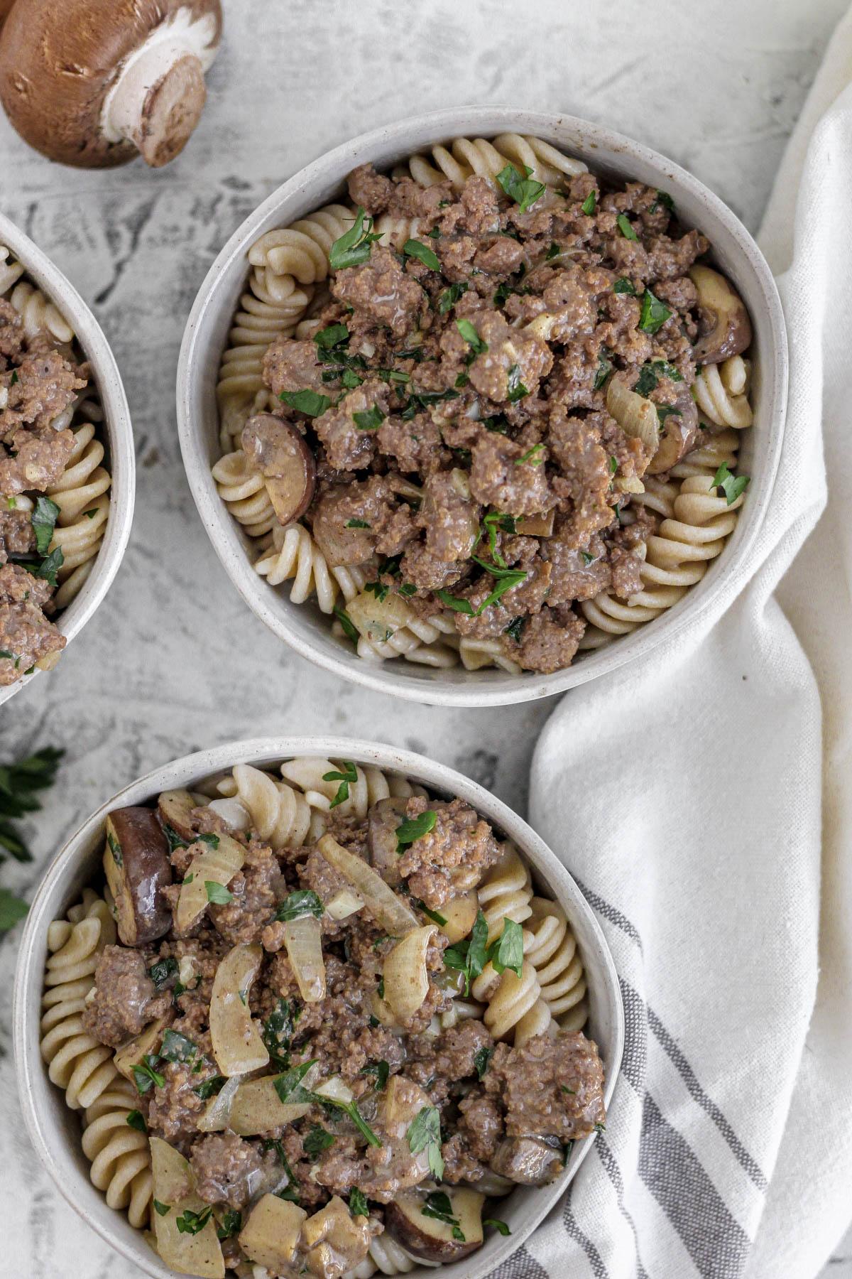 Three bowls filled with gluten free beef stroganoff